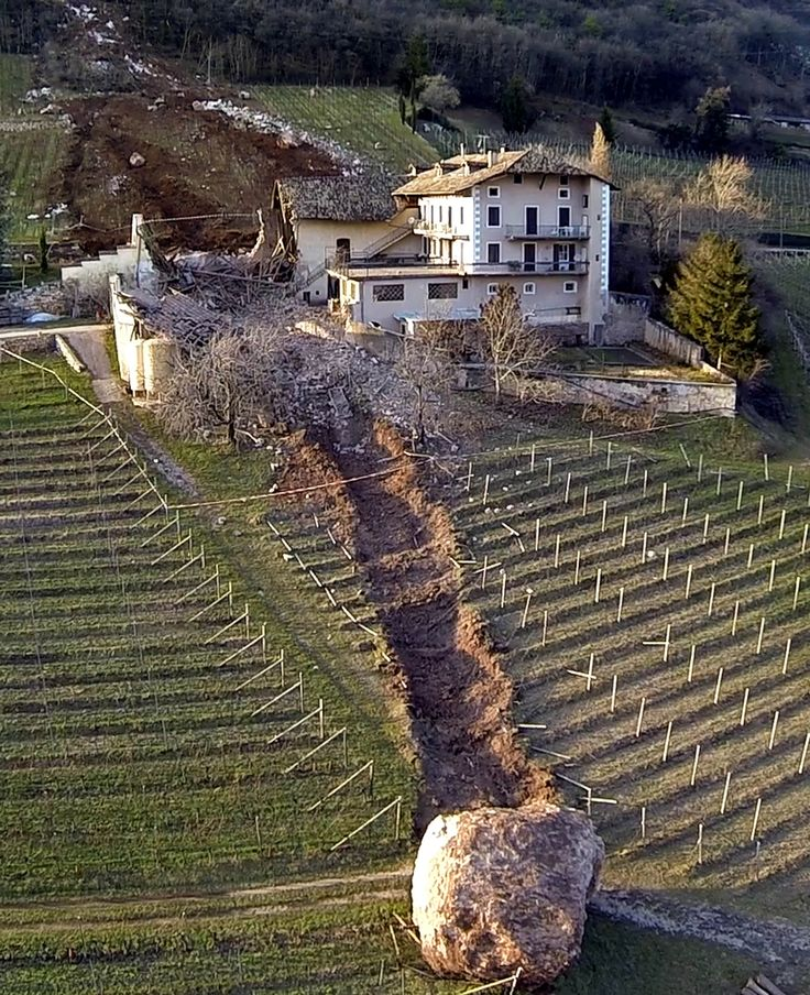 This farmhouse in northern Italy narrowly escaped total destruction by an enormous boulder. The massive slab of rock barrelled through the c...