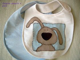 Baby bib with dog appliqué