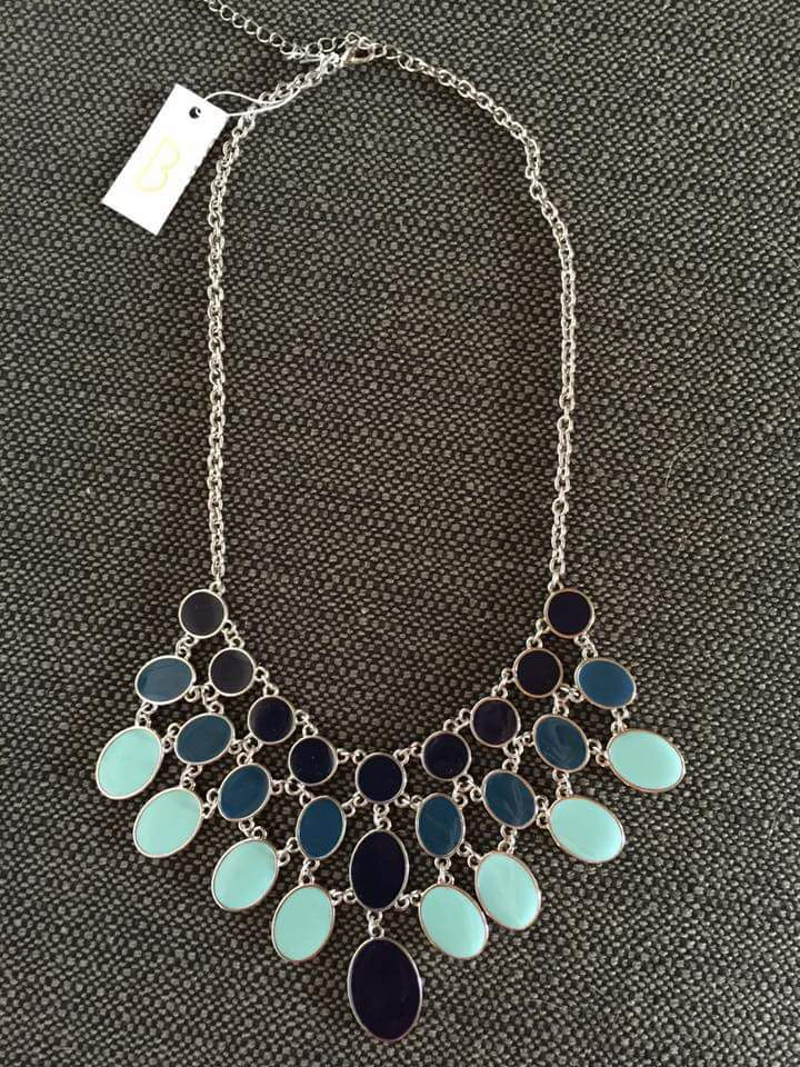 Silver statement necklace.   I love Stitch Fix! Personalized styling service and it's amazing!! Fill out a style profile with sizing and preferences. Then your very own stylist selects 5 pieces to send to you to try out at home. Keep what you love and return what you don't. Try it out using the link! https://www.stitchfix.com/referral/5634870