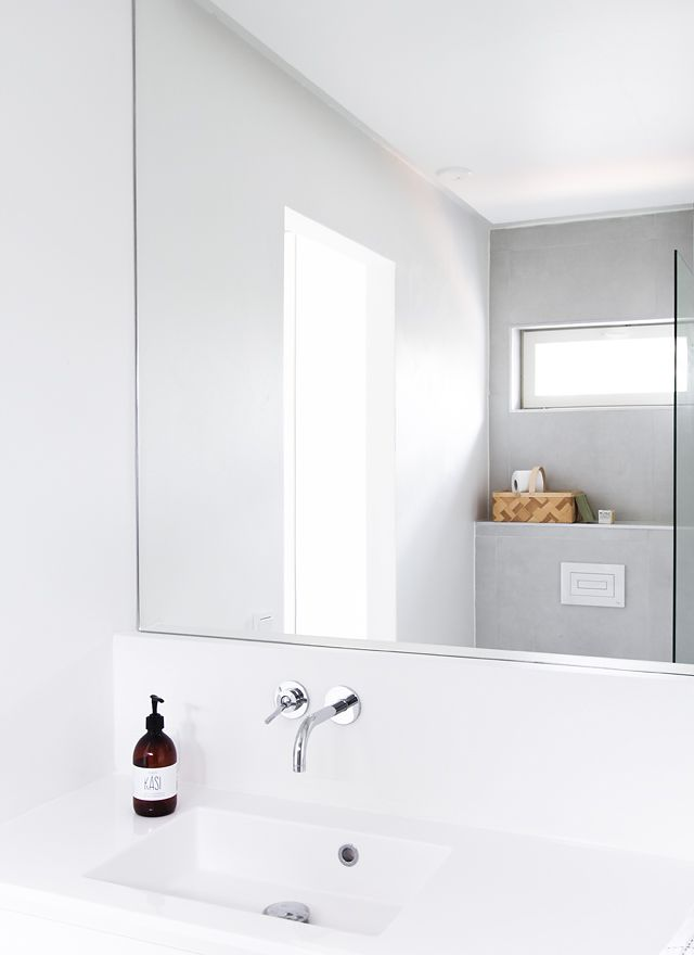 Great mirror with recessed cupboard behind and taps