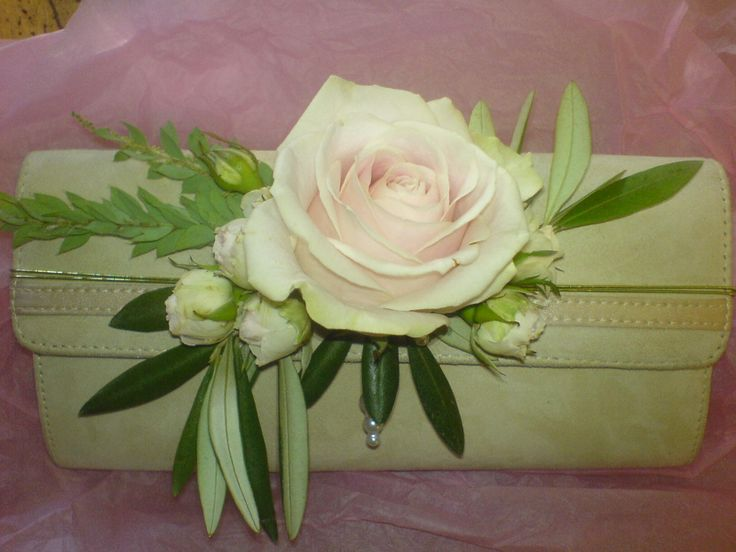 A clutch corsage! This would be gorgeous in your dress colors!