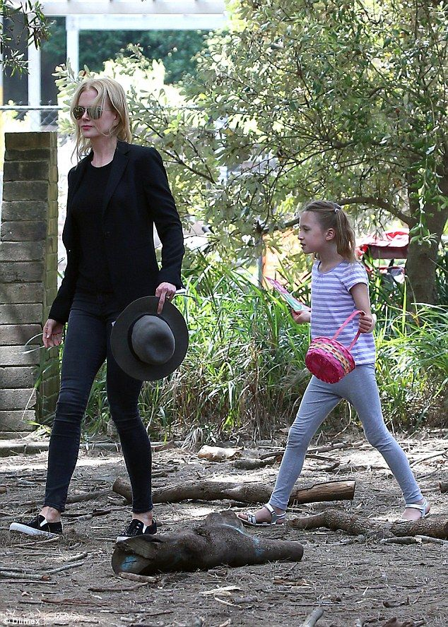 Hard luck? Nicole's daughter Sunday swung her basket in one hand, following her mother around the park