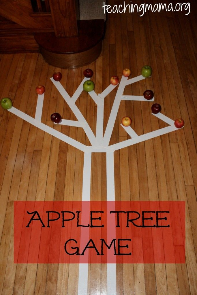 "This sounds like an amazing indoor gross motor activity! The children balance-walk on the tape, ""pick"" one apple and ""climb"" back down the tree to place in a basket below the trunk. Love it!"