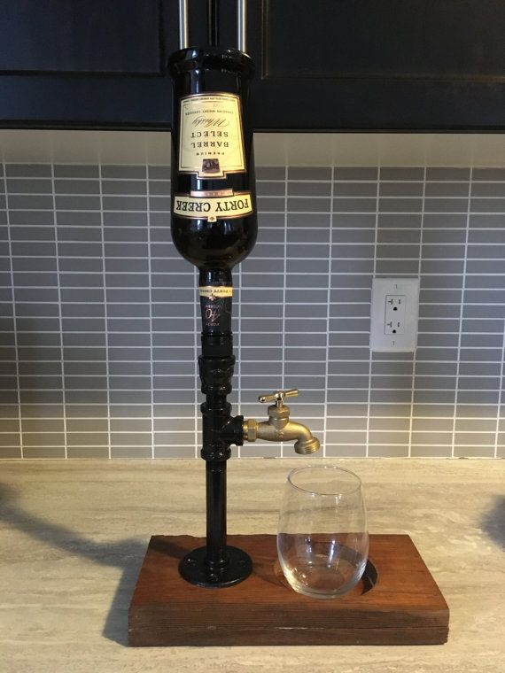 Up for sale is a one of a kind liquid dispenser, all iron and the wood platform is from a 100 year old barn board wood. This is one of a kind. I can make a new one if you would like different options, can make the black as a silver and gold tap and can leave the wood as old looking and not stain it but just put a clear coat on it.