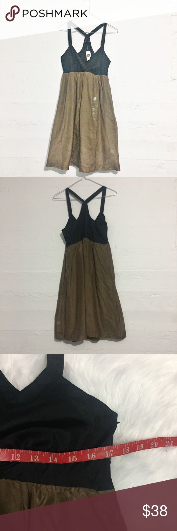 NWT The Gap Bronze & Black dress NWT The Gap Bronze & Black dress. Photographs cannot capture the shimmer to the brown-bronzey skirt of this dress. But it's gorgeous! Open to offers. No trades. GAP Dresses