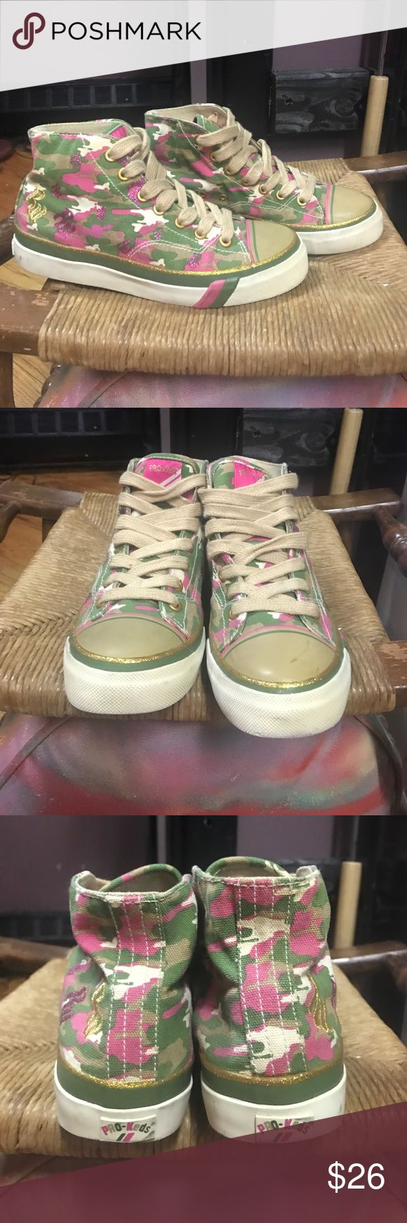 Roca Wear x Pro Keds camouflage sneakers Roca Wear x Pro Keds RARE, camouflage with pink & gold, platform, high top, sneakers. EUC. only flaw is a stain on the left toe (I'm sure this could come off with shoe cleaner) hard to find! Keds Shoes Sneakers