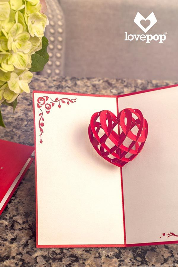 """Life can get hectic. Taking time as a couple to remember why you fell in love in the first place is essential. Give the Original lovepop card to someone special and let your feelings be known. The red cover of this lovely card features a laser-cut heart with intricate details and the word """"love"""" inside. Once opened a three-dimensional card heart pops out and melts your loved one's heart. There is never a wrong time to say """"I love you."""" Say it often, say it with a lovepop, and be remembered."""