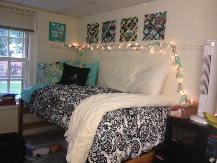 Dorm room set up at Wake Forest! Christmas lights allow you to not use the harsh overhead lighting all the time. The bedding is from PB Teen! The squares are cork boards painted and with ribbon so that pictures will stay! Also, the raised bed allows for TONS of storage underneath! Enjoy:)