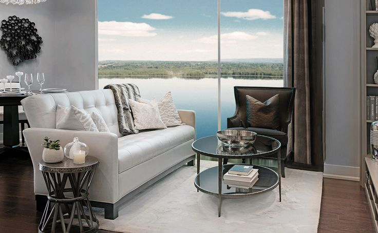 Highcroft model suite living room with view over Ottawa River. 2013 SAMMY Award for Best High Rise Condo.