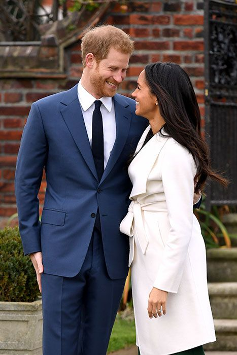 The couple looked head over heels in love as they posed in the grounds of Kensington Palace
