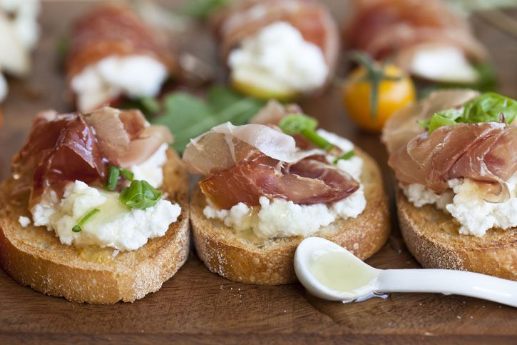 ... , prosciutto, basil and chives on crostini Honey Toast, Crostini