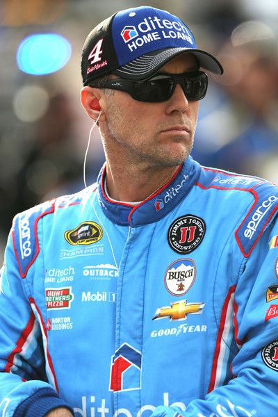 Kevin Harvick Photos Photos - Kevin Harvick, driver of the #4 ditech Chevrolet, stands on the grid prior to qualifying for the NASCAR Sprint Cup Series Bad Boy Off Road 300 at New Hampshire Motor Speedway on September 23, 2016 in Loudon, New Hampshire. - New Hampshire Motor Speedway - Day 1