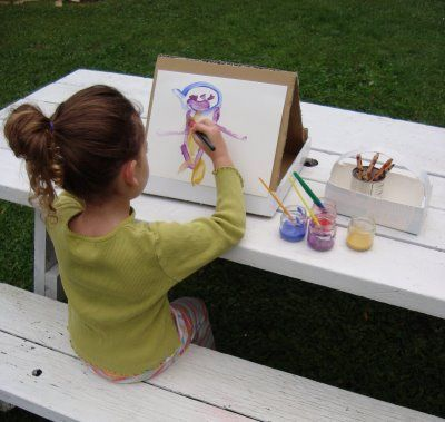 This is a portable art studio using cardboard and a milk carton... by maya*made...genius