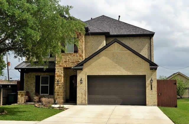 Make An Old Home Feel New Again With New Exterior Home Siding Garage Door Styles Garage Doors Wooden Garage Doors