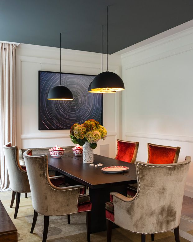 """love the orange on chair fronts. """"A dark dining room ceiling — deep blue or black — gives the impression of the night sky. It's perfect for a room often used after dark. Use flat finish paint to maximize the drama and depth."""" – Margot Austin, Senior Design Editor"""