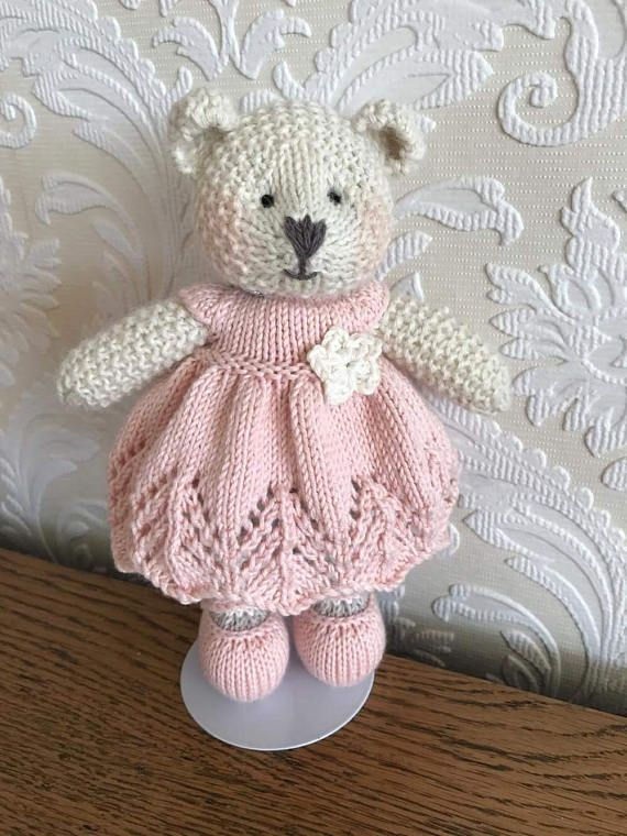 Say hello to this gorgeous bear! She is hand knitted using beautiful baby alpaca wool. Her pretty little dress is made from 100% cotton and is removable. Her shoes can not be removed. She is made using all new materials and is stuffed with crest-a-Lon fibre filling. This bear is
