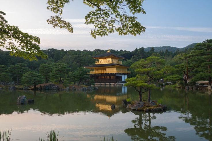 The beautiful Kinkaku, or the Golden Pavilion in Rokuonji temple reflected in a pond at sunset. Kyoto, Japan.   This photo is published under Creative Commons Attribution-NonCommercial 3.0 license.