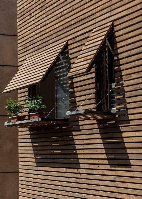 Inward Facing Iranian Home Lets Light Filter In Through A Facade Of Wooden Slats Facade Architectureresidential Architecturegreen Gardendesign