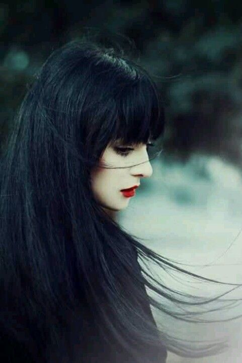 Black hair. Red lips. Classic look.