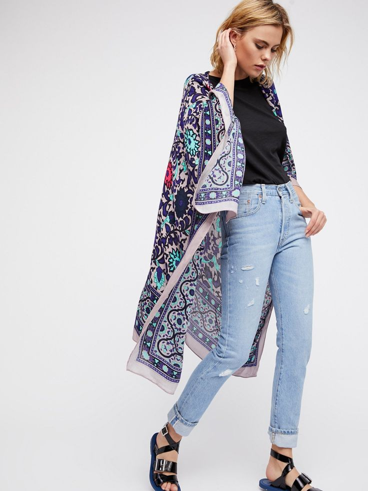 Palm Highway Cardi   Drape on this printed knit cardi in an effortless maxi silhouette featuring a front toggle closure for an easy layered look.