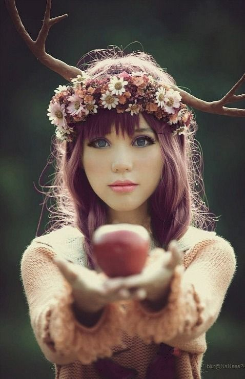 OMG IT'S A HUMAN DEER CREATURE OFFERING ME AN APPLE. THAT APPLE IS PROBABLY POISONOUS. COME ON CREEPY DEER LADY! WHY WOULD YOU WANT TO KILL ME? IM A NICE PERSON! SHE IS STARING INTO MY SOUL. TIME FOR ME TO GET OFF PINTEREST BEFORE THIS CREEPER EATS MY FACE.