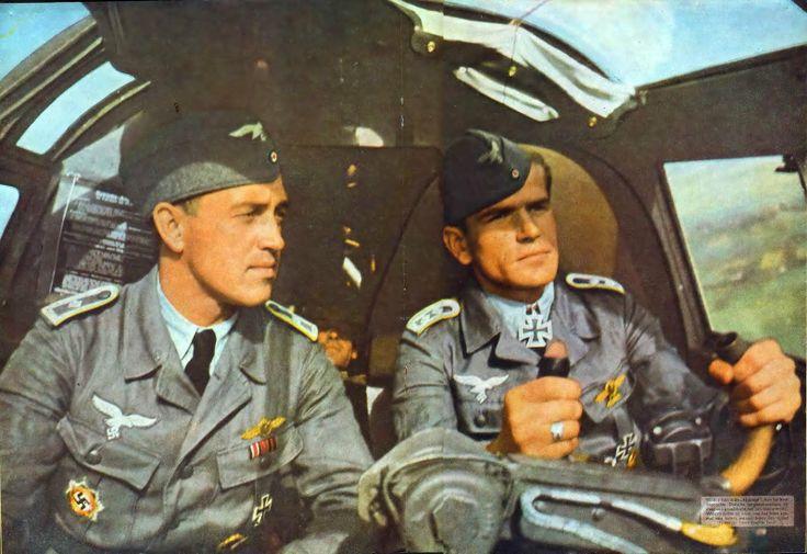 "Oberfeldwebel Johann-Peter Oekenpöhler (right) with his co-pilot. The original caption from SIGNAL magazine: ""wei Frontbewährte dt. Feldwebel probieren ein neues Modell aus. Bald sind sie wieder an der Front und noch besser für den Feind gerüstet"" (Two front sergeant try a new model for approval. Soon they are back on the front and even better equipped for the enemy). Luftwaffe Bomber Aces, Luftwaffe Oberfeldwebel, Ritterkreuzträger"