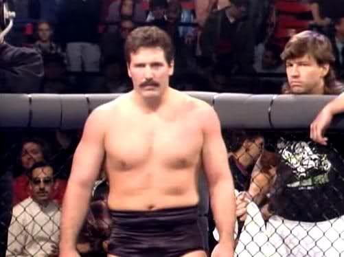 Al Snow cornering Dan Severn at UFC events.