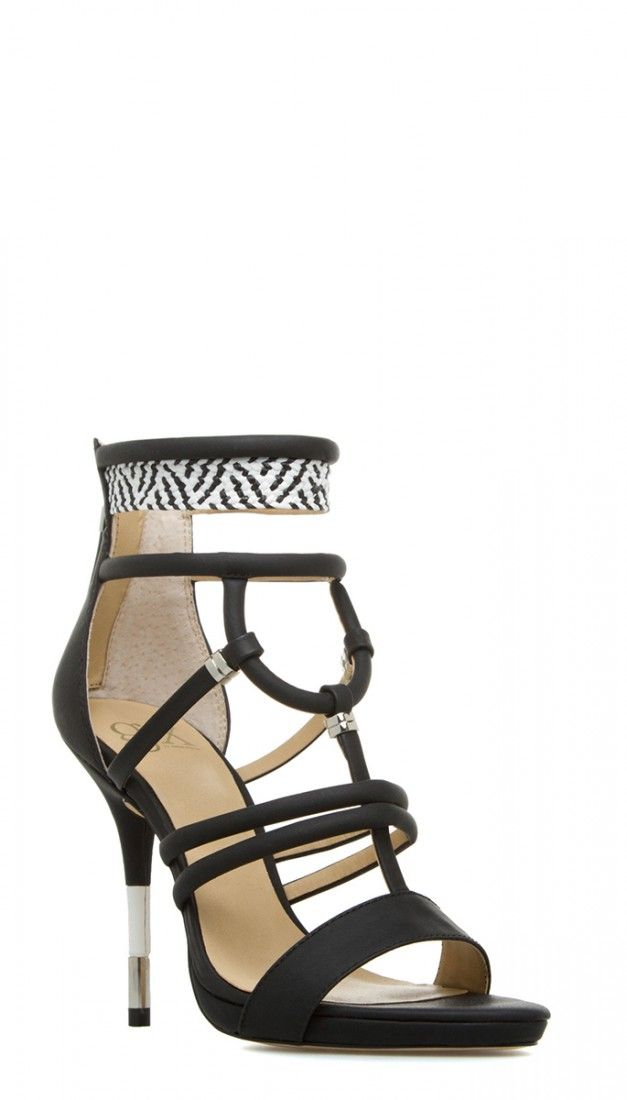 A woven, patterned panel accentuates the ankle strap of this GX BY GWEN STEFANI dress sandal.