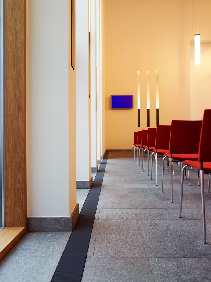 Our Convec FloorLine is one of the smallest and most compact heating systems on the market but despite that, the performance is outstanding. FloorLine can be integrated into floors as a discreet architectural detail – just like in this beautiful Danish church #floorline #heating #radiators #heatingsolutions #church