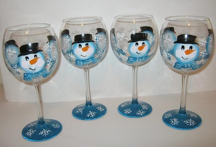 Set of 4 Snowman Hand Painted Wine Glasses with Snowflakes. $50.00, via Etsy.