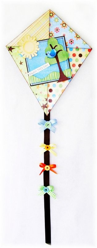 Kite (could be paper or material, add buttons & bows to satin tail, and novelty pins and embellishments onto the body. Cute for office or kid's room (little K could clip her barrettes and hair bows onto tail).  (Blog: An Altered State Of Mind)