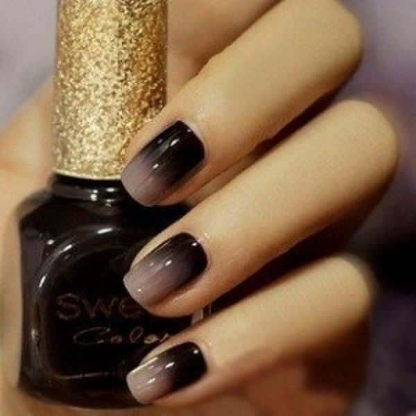 Black and gray Ombre nail art. A wonderful looking combination that gives a soft touch on the tips of your nails and a silhouette effect on the inner side of the nails.