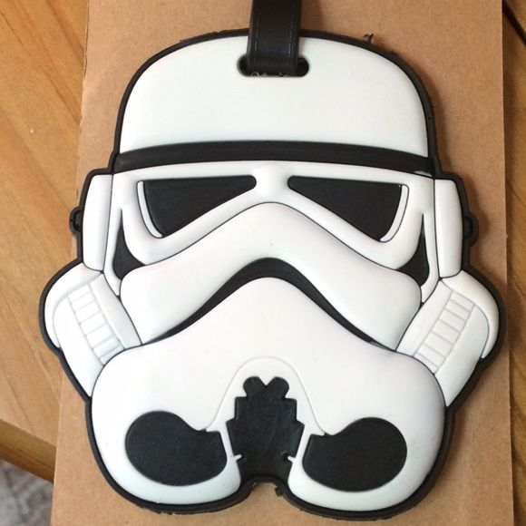 "Star Wars Storm Trooper Luggage Tag Give your bag a distinct look! Detailed & unique white Stormtrooper helmet luggage tag/name plate. Back of tag has place to write name & address. Approximately 6"" L x 3.5"" W. Other luggage tags and Star Wars items available. Not all Storm Trooper tags available on card back. Please ask if you have questions. Rogue One. Force. Awakens. Kylo. Jedi. Vader. Science Fiction. Costume. Cosplay. Vacation. Classic. Holiday. Gift. Travel. Sci fi. Sith. Accessories"