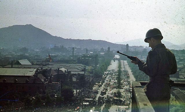 """Overlooking the parade honoring Syngman Rhee's return to Korea in October 1945."""