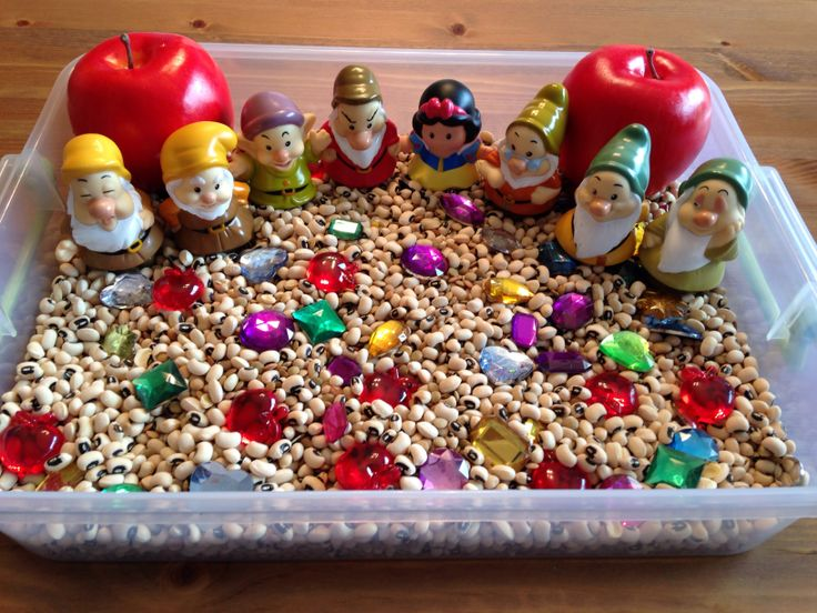 Snow White Mining Sensory Bin - contains black eyes peas and lentils, jewels, and clear red apples - Snow White Movie Night - Disney Movie Night - Family Movie Night