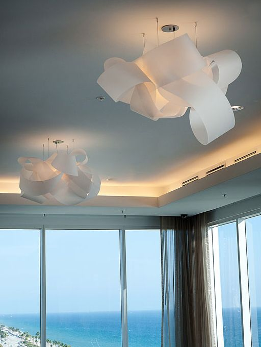 CUSTOM CLOUD FIXTURES (translucent suede)This hotel renovation in Miami called for delicate fixtures with a modern-classic feel. Sweeping bands create soft loops, evoking the wavy surf and warm breeze of the surrounding site. #MaterialRepublic #3form #Lighting #InteriorDesign