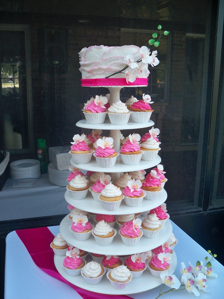 Pink Orchid Wedding cake and cupcakes