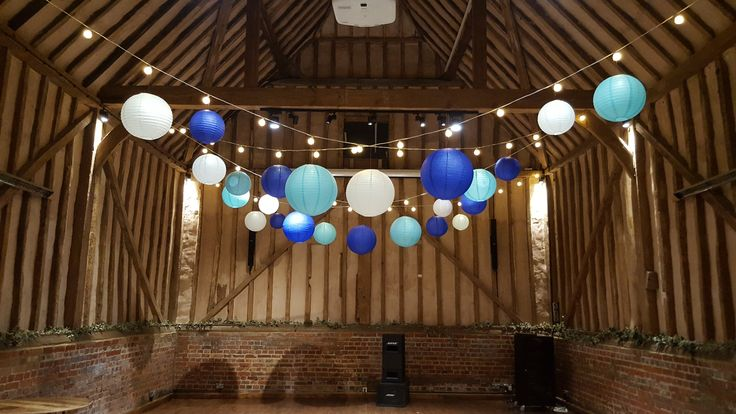 A lovely Royal Blue, Baby Blue and White Hanging Lantern Canopy with Warm White Festoon over the dance floor in the very impressive Great Barn. #lanternlove #festoonlighting #festoon #weddinglighting #barnwedding #eventprofs #berkshire #buckinghamshire @Lillibrooke Manor