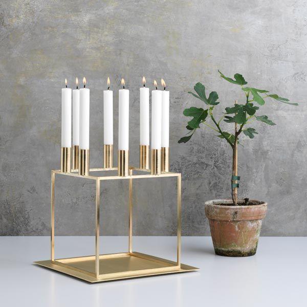 By Lassen's Kubus 8 candleholder, brass.