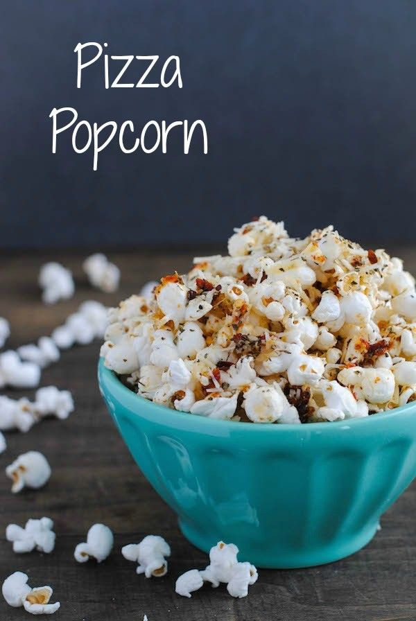 **PERFECT FOR OSCAR NIGHT** Pizza Popcorn - Start with a big bowl of popped popcorn, then whip up a quick pizza-flavored olive oil that includes sun-dried tomatoes, Parmesan cheese, and lots of Italian herbs.   foxeslovelemons.com