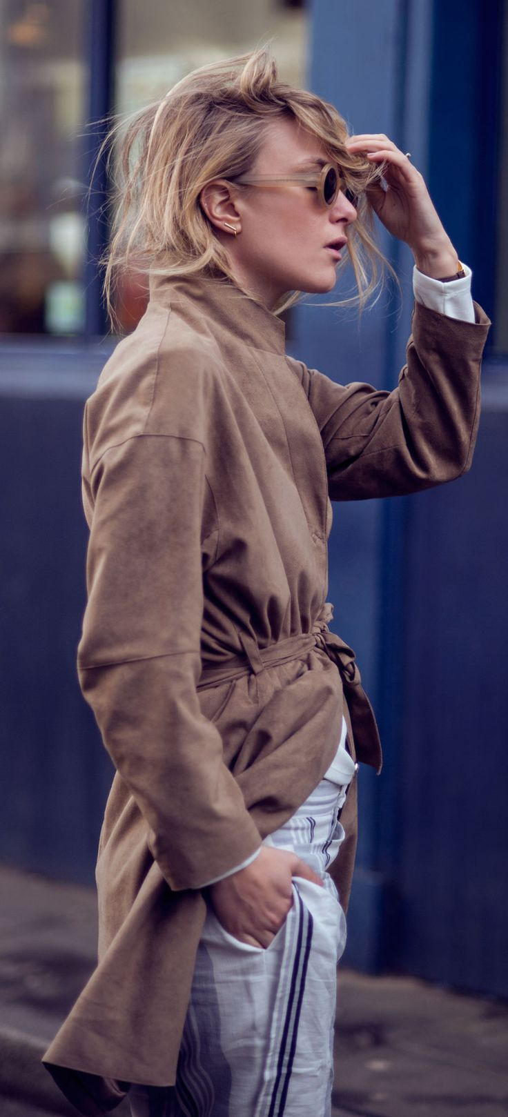 Suede Outfit: Rebecca Laurey is wearing a tan suede coat from Filippa K