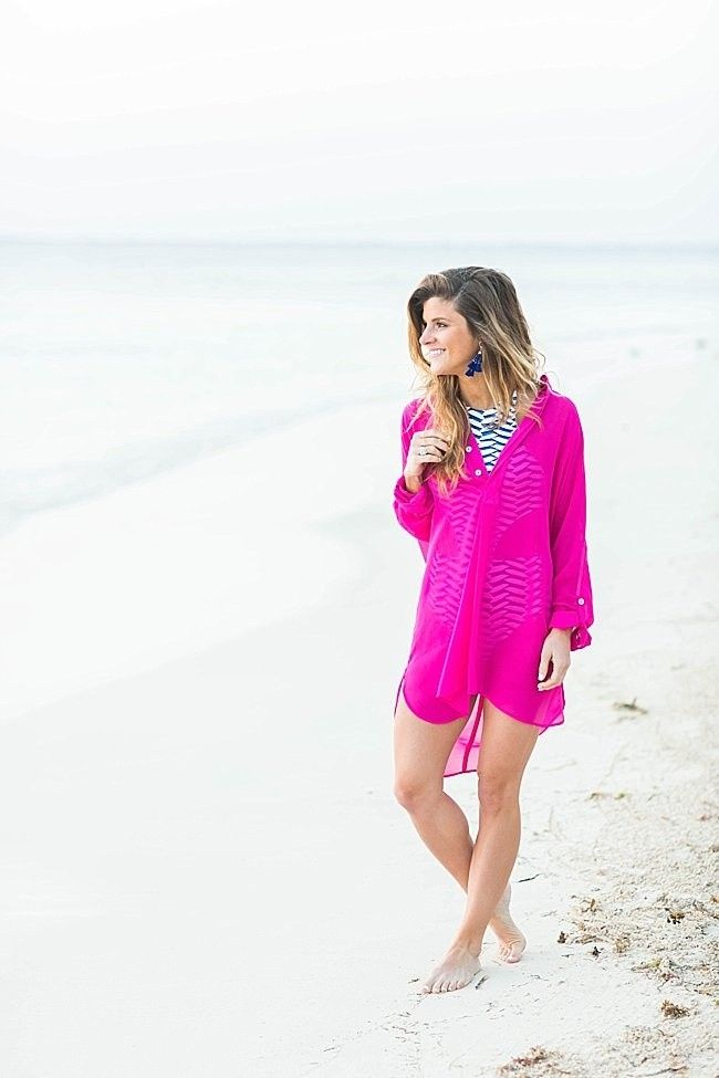 @brightonkeller // BrightonTheDay Blog // Beach Day Outfit // Hot pink sheer cover up // cut out blue and white one piece swimsuit // cobalt blue tassel earrings