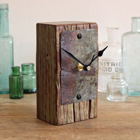 A one of a kind small mantel clock or desk clock has been handmade in Norfolk England. The wooden body of the clock has been cut from a piece of driftwood discovered along the beautiful local coastline, it has been cleaned and lightly sanded to retain the character. The face has been made from a piece of rusty beach metal which has a beautiful natural patina. It is held in place with black screws. There is a felt base to protect any surfaces this is placed on, and a hand stamped 'Reclaimed…