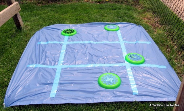 The Tic Tac Toe game is just a $1 shower curtain liner that we staked to the ground and then used blue painter's tape to draw the grid.: Tic Tac Toe, Kids Parties, Backyard Games, Turtles Life, Carnivals, Parties Ideas, Shower Curtains, Carnival Games, Turtle Life