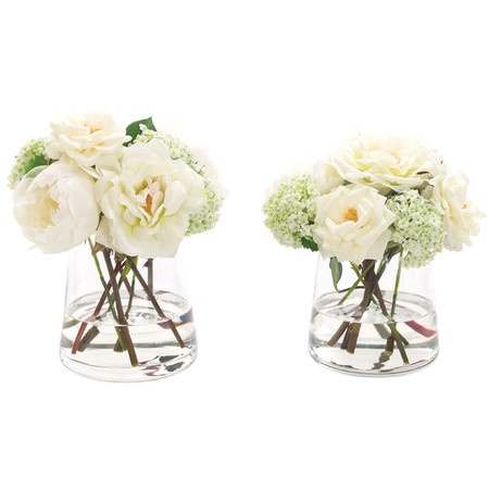 Add a delightful pop of style to your home with this lovely faux floral arrangement from Natural Decorations, Inc.   Product: Set...