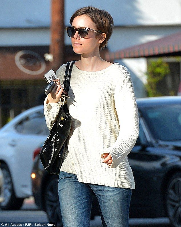 Shady lady: The 25-year-old looked low-key in big sunglasses and a casual outfit...