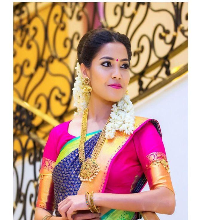 South Indian bride. Gold Indian bridal jewelry.Temple jewelry. Jhumkis.Blue silk kanchipuram sari with contrast pink blouse.braid with fresh jasmine flowers. Tamil bride. Telugu bride. Kannada bride. Hindu bride. Malayalee bride.Kerala bride.South Indian wedding.
