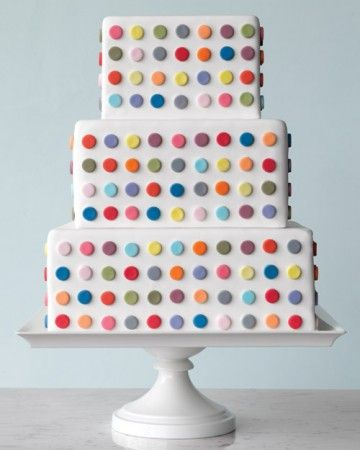 """The Inspiration: """"Spot"""" series, by English artist Damien Hirst, 1990sThis offbeat number -- perfect for a contemporary wedding where fun is the focus -- mirrors the artist's vivid grids of circles set against white canvas. Assistant food editor Elizabeth Colling punched out multicolored fondant dots using a round pastry tip and attached them to a white-fondant cake using a gum-paste solution.See the original piece of artwork and the inspiration for this cake."""