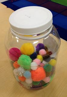 """Little Warm Fuzzy Jar: The whole class can earn """"Warm Fuzzies"""" when they display good behavior. I simply place a warm fuzzy in the jar when everyone is listening on the rug, or standing quietly in a line, etc. When the jar is full, we have a little celebration!"""
