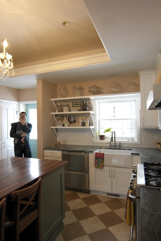 I love this kitchen from apartmenttherapy.com. The colors, the sink! I open shelves, the island, just lovely!